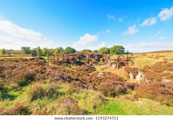 A long abandoned, overgrown, gritstone quarry on Stanton Moor, Derbyshire. Nearby stands the ancient Cork Stone.