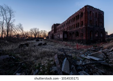 A long abandoned Pennsylvania Railroad YMCA as viewed at sunset in Canton, Ohio.