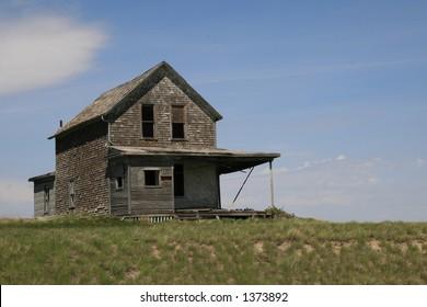 long abandoned prairie farmhouse