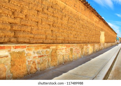 Long Adobe wall in Oaxaca, Mexico