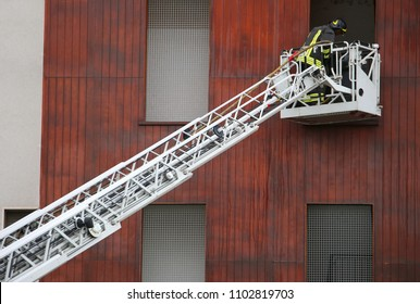 long aerial ladder and firefighters during an emergency