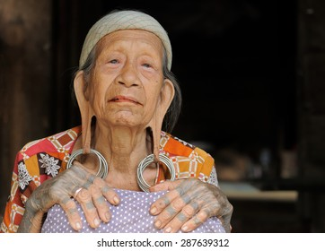 LONG BAGUN, BORNEO, INDONESIA - JULY 07: The older Dayak women with traditional long earlobes and tattoo from Borneo, Long Bagun on July 07, 2011