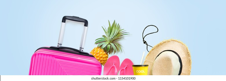 Long Banner Travel set fuchsia suitcase straw hat pineapple slippers isolated blue background. Trunk luggage Concept summer holiday adventure trip Flat lay collage Copy spase