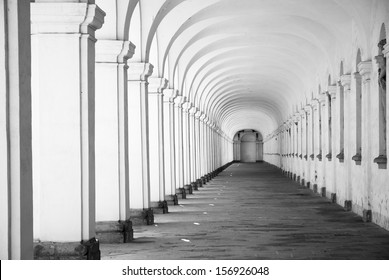 Long baroque arcade colonnade interior in black and white tone