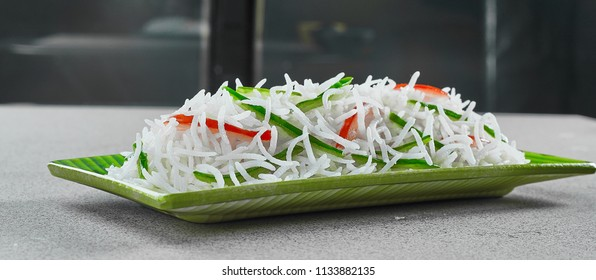 Long Basmati Rice in Different Bowls and Plates