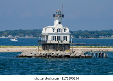Long Beach Bar (Bug) Light is a lighthouse off Orient, New York. It was originally a screwpile lighthouse that was later converted to concrete caisson foundation.