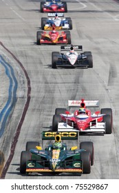 LONG BEACH, CA. - APR 17: Tony Kanaan in the #82 leads a small chase group during the Toyota Grand Prix of Long Beach on April 17, 2011 in Long Beach, CA.