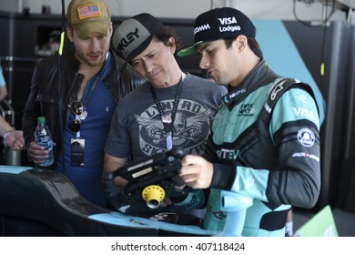 LONG BEACH, CA - APRIL 2:   Actors Austin Stilwell and Clifton Collins Jr.get a VIP tour of  Nelson Piquet Jr.'s garage before the FIA Formula E Long Beach E Prix April 2, 2016 in Long Beach, CA.