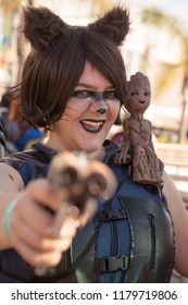 Long Beach, CA - Feb 17: Cosplayer Amanda shows off her Rocket Raccoon inspired costume with Baby Groot at the Long Beach Comic Expo on Feb 17, 2018 in Long Beach.