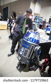 Long Beach, CA - Feb 17: A droid builder works on an R2 unit at the Long Beach Comic Expo on Feb 17, 2018 in Long Beach. Maker culture overlaps with Star Wars in this popular hobby.
