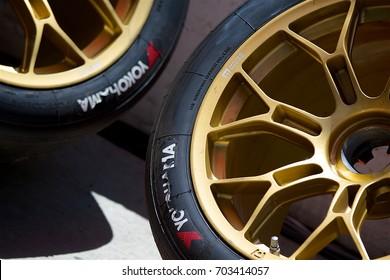 LONG BEACH, CA - MAY 1, 2016: Two Yokohama race slicks mounted on gold Motegi Racing rims await their turn on the track.