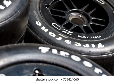 LONG BEACH, CA - MAY, 1 2016: A stack of Firestone race slicks mounted on OZ racing wheels stand by for the next race.