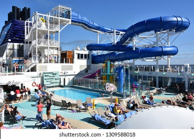 LONG BEACH, CA - OCT 23: Pool deck on the Norwegian Bliss cruise ship, sailing past Long Beach, California, on Oct 23, 2018. The ship entered service on April 21, 2018.