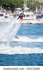 LONG BEACH, CA - September 21: Unidentfied man demonstrates flyboard acrobatics in Long Beach on September 21, 2013, in Long Beach, CA