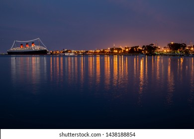 Long Beach, CA / USA - June 29, 2019: The Queen Mary Ship docked in Long Beach at night