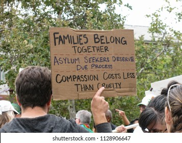 Long Beach, California USA–June 30, 2018: At a Keep Families Together rally against Trump immigration policy, a sign urges due process and compassion for asylum seekers forced to flee their countries.