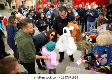 Long Beach, California Dec. 21, 2019. Police Chief Robert Luna deliver and volunteers deliver Christmas presents to the Navarro - Sexton family as part of the annual police department tradition.