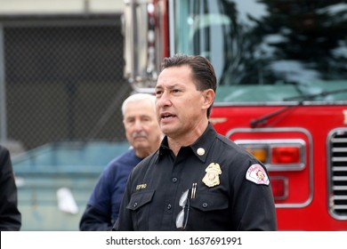 Long Beach, California Dec. 21, 2019. Fire chief Xavier Espino before Long Beach's annual holiday caravan of volunteers delivers gifts to families in need.