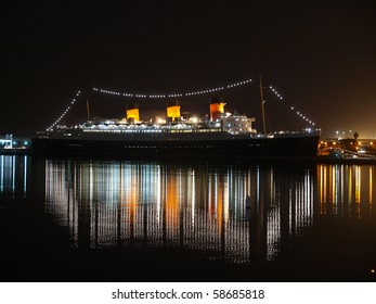LONG BEACH CALIFORNIA - FEBRUARY 10:  Historic Queen Mary shines brightly at night February 10, 2009 in Long Beach, California.