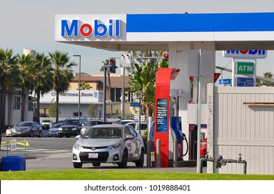 Long Beach, California - January 15, 2018:  Car about to fill up at Mobil gas station.