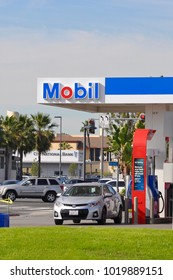 Long Beach, California - January 15, 2018:  A car is about to fill up at Mobil gas station.