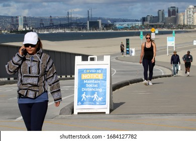 Long Beach, California March 25, 2020. Signs encourage social distancing along a fitness path in Long Beach, Calif. as city and health official try to stop the coronavirus from spreading.
