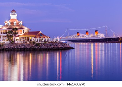 Long Beach, California / United States of America - July 21st 2019: The Queen Mary from Rainbow Harbor.