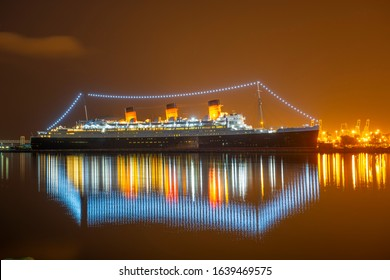 LONG BEACH, CALIFORNIA, USA - JUN. 22, 2019: Queen Mary at night at harbor in city of Long Beach, Los Angeles County, California CA, USA.