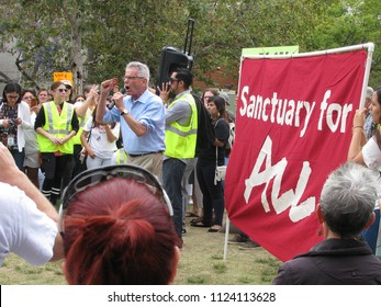 Long Beach, California USA - June 30, 2018: US Representative, Congressman Al Lowenthal speaks to demonstrators at the Families Belong Together rally against immigrant detentions at Cesar Chavez Park.