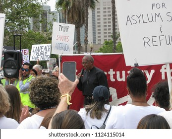 Long Beach, California USA - June 30, 2018: Reverend Leon Wood addresses demonstrators at the Families Belong Together rally against separating immigrant families at Cesar Chavez Park.