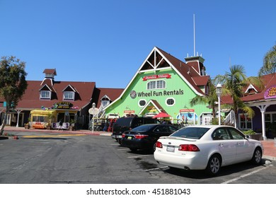 Long Beach, California, USA - March 16, 2016: Shoreline Village is a charming shopping village featuring colorful boardwalk shops and restaurants with Rainbow Harbor view.