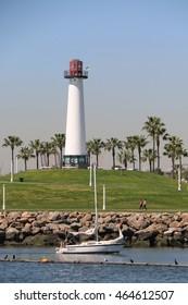 Long Beach, California, USA - March 16, 2016: Unidentified man is sailing yacht near Pine Avenue Pier in Queensway Bay.