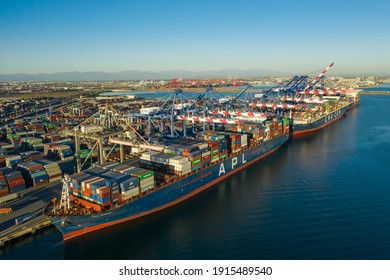 Long Beach, CaliforniaUSA - January, 30th 2021: Aerial view of intermodal, freight ships with thousands of containers docked at the port