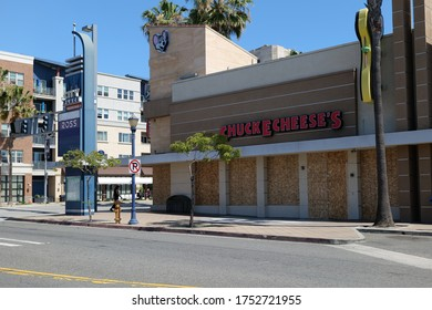 Long Beach, CA/USA - June 6, 2020: Chuck E Cheese boarded up after looting and vandalism during the Black Lives Matter protests