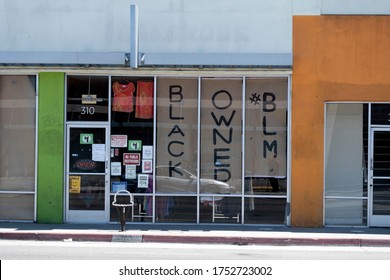 Long Beach, CA/USA - June 6, 2020: A business in the area of looting during the Black Lives Matter protests in Long Beach has signs in the windows reading Black Owned Business