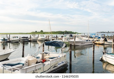 LONG BEACH ISLAND, NEW JERSEY - July 3, 2018: Boats and pontoons docking in the bay on Long Beach Island during the 4th of July holiday