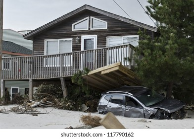 LONG BEACH ISLAND,NJ-NOVEMBER 1: A car is pinned under the deck of house after being swept away by the powerful storm surge caused by Hurricane Sandy in Holgate.Nov 1 2012, Long Beach Island, NJ
