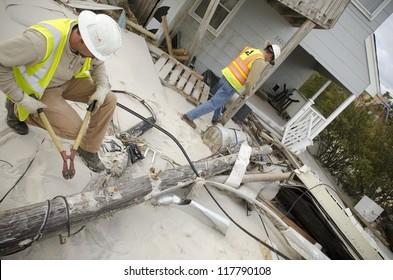 LONG BEACH ISLAND,NJ-NOVEMBER 1: Linemen struggle to restore power to the areas stricken by Hurricane Sandy on Long Beach Island, NJ.Nov 1 2012, Long Beach Island, NJ