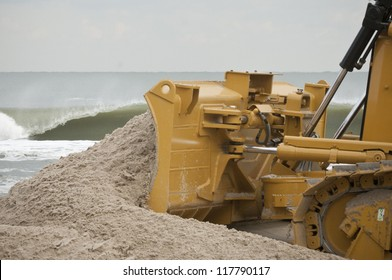 LONG BEACH ISLAND,NJ-NOVEMBER 3:A bulldozer pushes sand back up to the dunes after it was lost from the tidal surge caused by Hurricane SandyNov 3 2012, Long Beach Island, NJ
