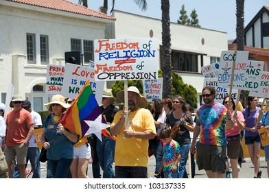 LONG BEACH - MAY 20: People with signs demanding freedom of religion, at the Long Beach Lesbian and Gay Pride Parade 2012 on May 20, 2012 in Long Beach, California.