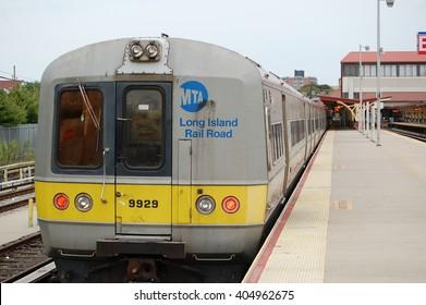 Long Beach, NY, USA - September 8, 2009: Long Island Railroad train arriving at station