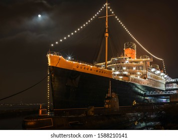 Long Beach, USA-12/13/19; Christmas lights on Queen Mary is shinning at the harbor.