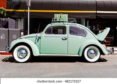 LONG BEACH/CALIFORNIA - SEPT. 11, 2016: Classic Volkswagen Beetle donned with accessories parked along the street in Belmont Shores in the city of Long Beach, California USA