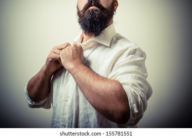 long beard and mustache man with white shirt on gray background
