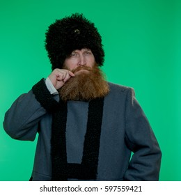 Long bearded man in hat and coat, on chromakey.