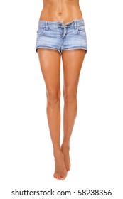 Long beautiful tanned slim legs of young sexy woman in blue denim shorts, on white background