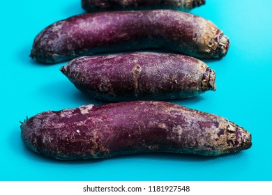 a lot of long beets on a blue background, top view