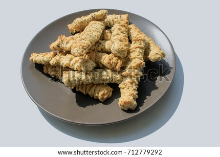 Long Biscuits Poppy Seeds On Plate Stock Photo Edit Now 712779292