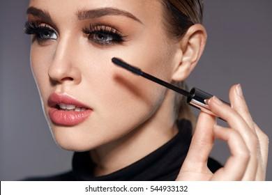 938bb5bff30 Long Black Eyelashes. Closeup Of Beautiful Sexy Girl With Mascara Brush  Near Face. Glamorous