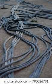 long black power cables cords on the ground heavy carnival ride machinery electrical source